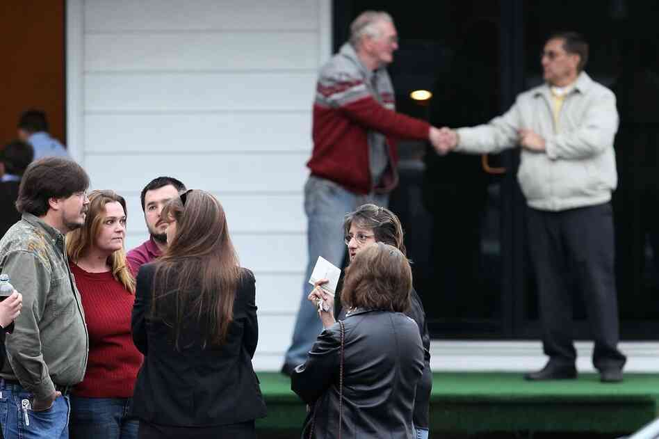 Jennifer Scott (second from left), daughter of Deward Scott, one of the miners killed in the mine explosion, greets well-wishers during a wake at Armstrong Funeral Home in Whitesville, W.Va., on Thursday. Armstrong is the site of several of the funerals for the 25 miners killed in the disaster.