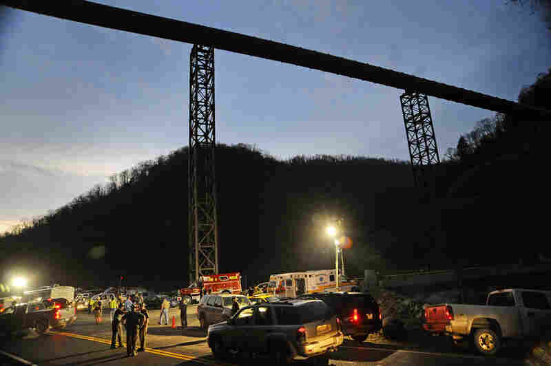 West Virginia State Police direct traffic Monday at the entrance to Massey Energy's Upper Big Branch Coal Mine in Montcoal.