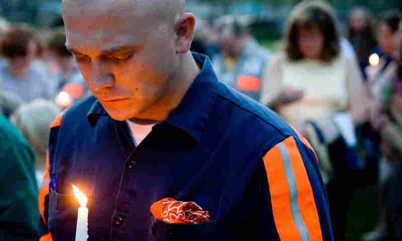 Thomas Jones, a local coal miner, participates in a candlelight vigil in Whitesville on Wednesday for the 25 miners who were killed in an explosion at the Upper Big Branch coal mine in nearby Montcoal.