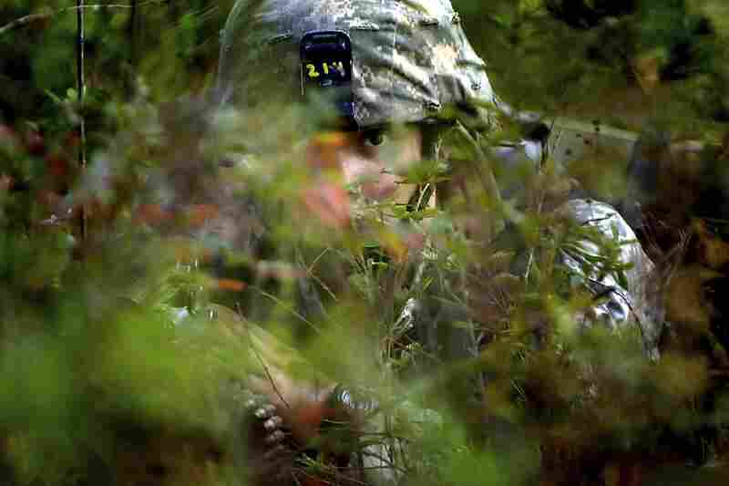 Sept. 13, 2007. 9:28 a.m. It's near the end of basic training, and the troops are deep into their weeklong Field Training Exercise, where they put all their newly learned skills to the test. Ian takes cover in the woods as his squad offers security for other platoon members raiding a trench.