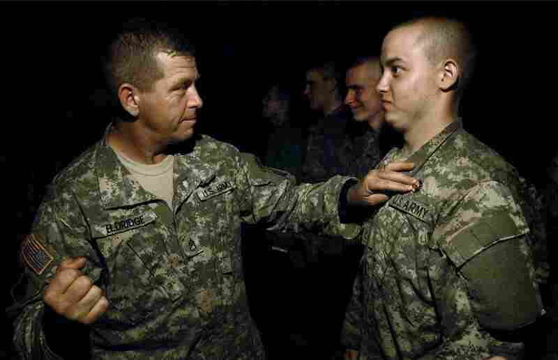 "Sept. 17, 2007. 12:50 a.m. Ian braces for the pain of receiving his crossed-rifles pin. The pin is secured with a fist to the chest. ""My mind was blown away,"" Ian says. ""I felt like I was part of an elite group, a brotherhood. I do feel changed, honestly."""