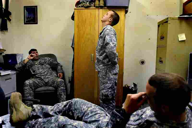 July 24, 2008. 2:12 p.m. Ian shows his frustration during a counseling session with Sgt. 1st Class Weisensel (left) and Sgt. Donoso. In addition to admitting to drug use, Ian returned late from the weekend again and lied about his reasons, putting him at risk of getting kicked out of the Army.