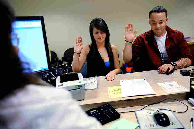 Aug. 24, 2009. 10:14 a.m. Three days after his return from Iraq, it's a big day for Ian and Devin. At the Jefferson County clerk's office in Golden, Colo., the couple swear to the accuracy of their marriage-license application. They were eager to get married immediately, but they do plan to follow up with a larger ceremony for family in the future.