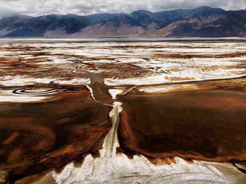 """Steamboats once plied Owens Lake before Los Angeles diverted the Owens River into an aqueduct. Dust from the dry lake bed is now a major source of air pollution."""