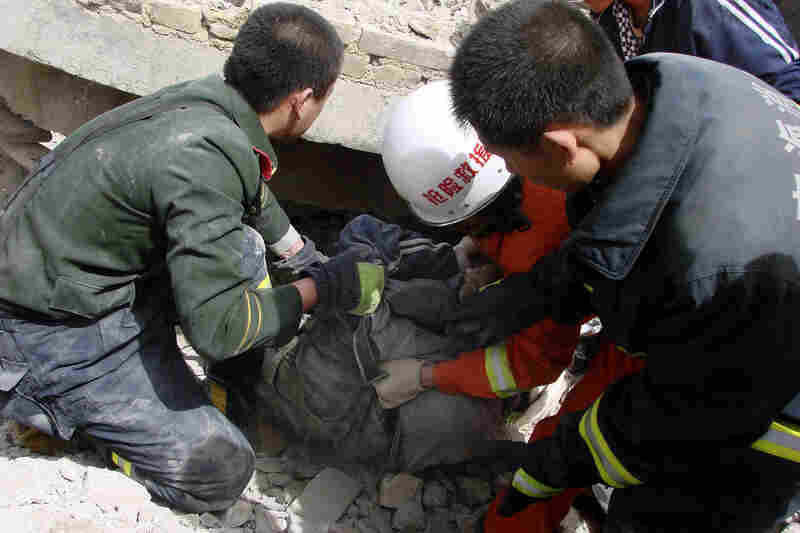 Rescue workers pull out a person from a collapsed building in Yushu. The largest earthquake struck at 7:49 a.m. local time and had a magnitude of 6.9, according to the U.S. Geological Survey.