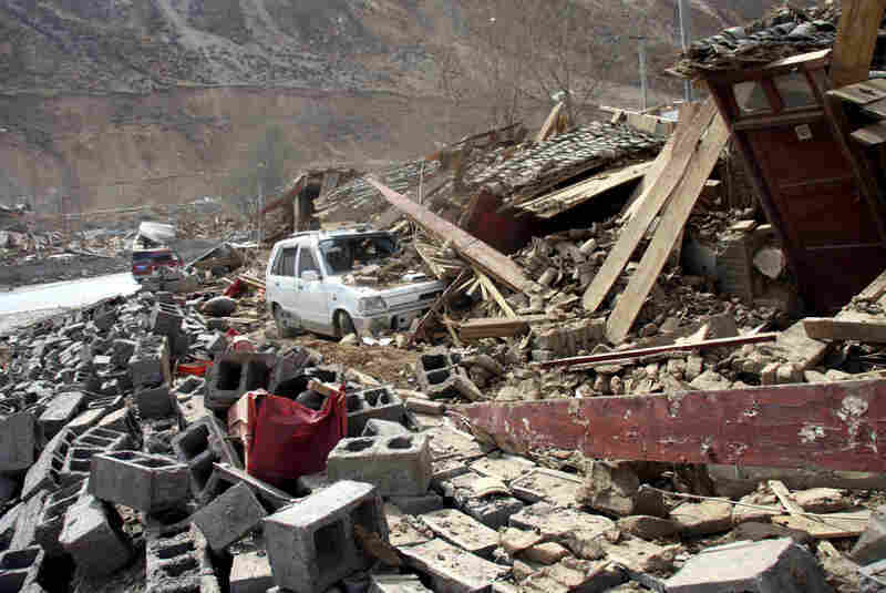 A car is buried under the rubble after an earthquake. Qinghai province averages more than five earthquakes a year of at least magnitude 5.0 according to Xinhua news agency.