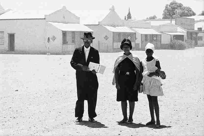 An elder of the Dutch Reformed Mission Church walking home with his family after the Sunday service, Carnavon, January, 1968