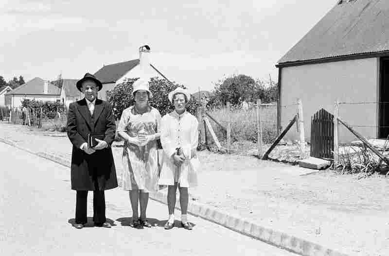 An elder of the Dutch Reformed Church walking home with his family after the Sunday service, George, January 1968