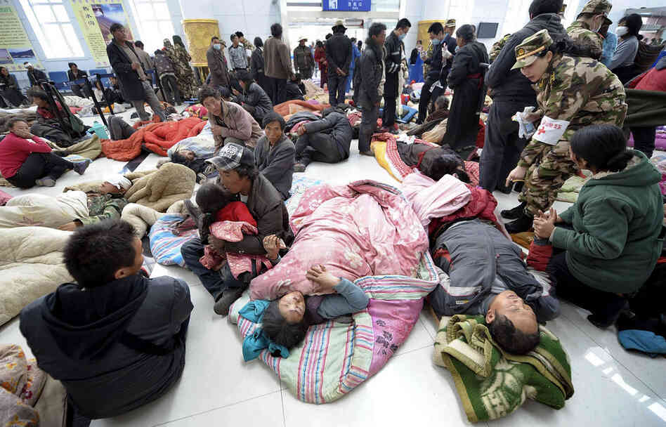 Injured survivors take refuge at Yushu airport as they wait for medical attention and transfer. Reports circulated that virtually the entire population of Yushu county have had to be moved to safety.