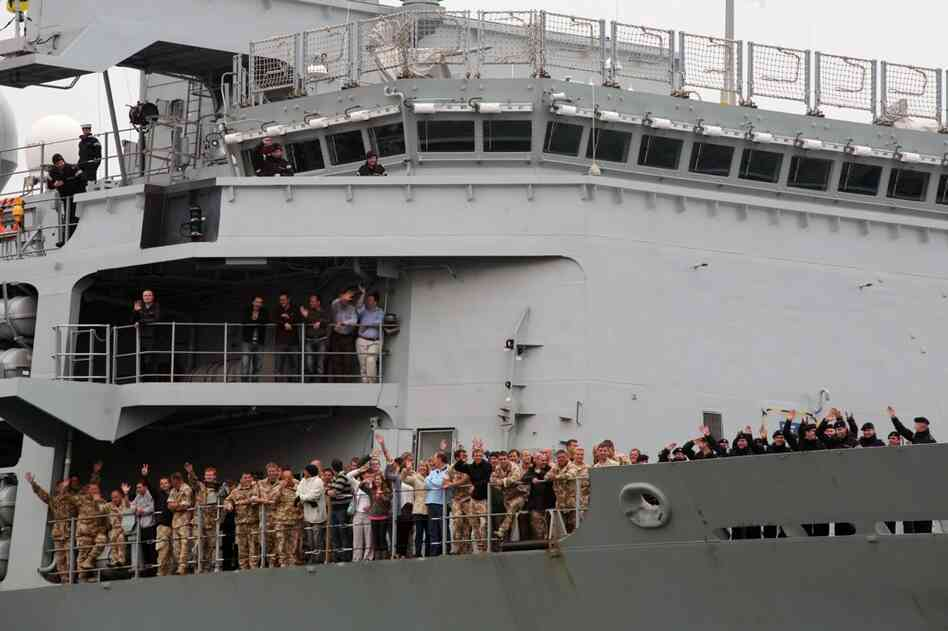 British passengers board HMS Albion on April 20 in Santander, Spain. The Royal Navy's ship, carrying service personnel home from Afghanistan, stopped to collect approximately 200 British citizens who were left stranded when their flights were canceled because of volcanic ash.