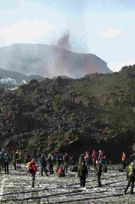 With lava still gushing, a small Icelandic volcano that initially sent hundreds fleeing from their homes has turned into a boon for the island nation's tourism industry, as visitors flock to catch a glimpse of the eruption.