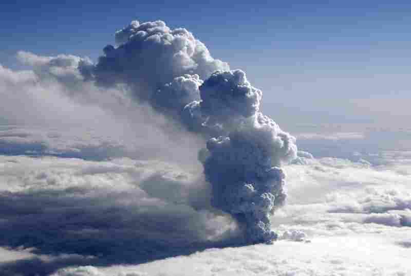 Smoke billows from an erupting volcano near the Eyjafjallajokull glacier on April 14, near Reykjavik.