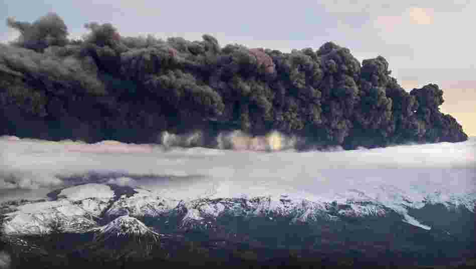 Smoke and steam hang over the volcano under the Eyjafjallajokull glacier on April 14. Volcanic ash drifting across the Atlantic forced the cancellation of flights in Britain and disrupted air traffic across northern Europe, stranding thousands of passengers.