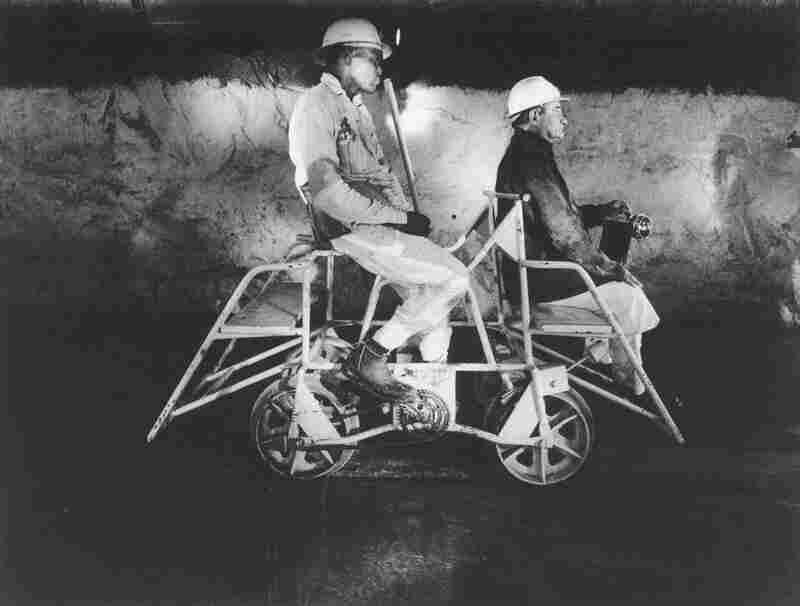 Team Leader and Mine Captain on a pedal car in the Rustenburg Platinum Mine, Rustenburg, 1971