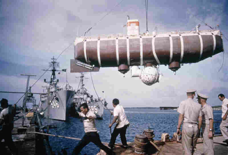 The Trieste swings on cables at Apra Harbor in Guam. At maximum water depth, the vessel's passenger sphere withstood the weight of five battleships.