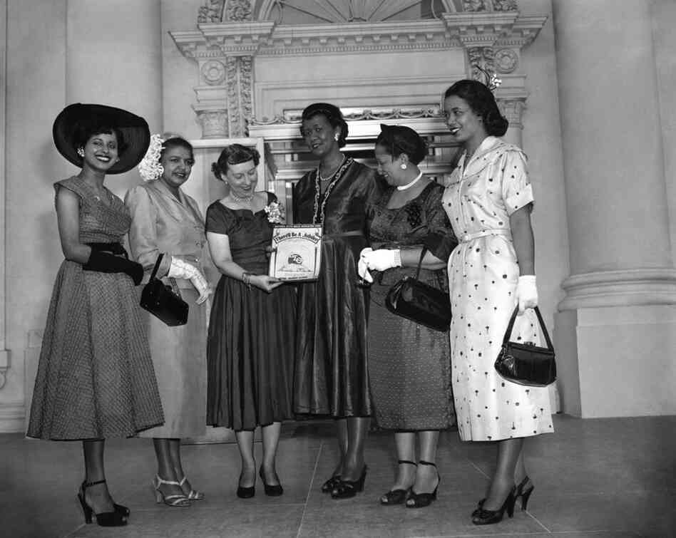 "Height (third from right) and other members of Delta Sigma Theta Sorority Inc. present Mamie Eisenhower with a copy of their song, ""There'll be a Jubilee,"" on May 14, 1953. Height was national president of the sorority from 1946-1957."