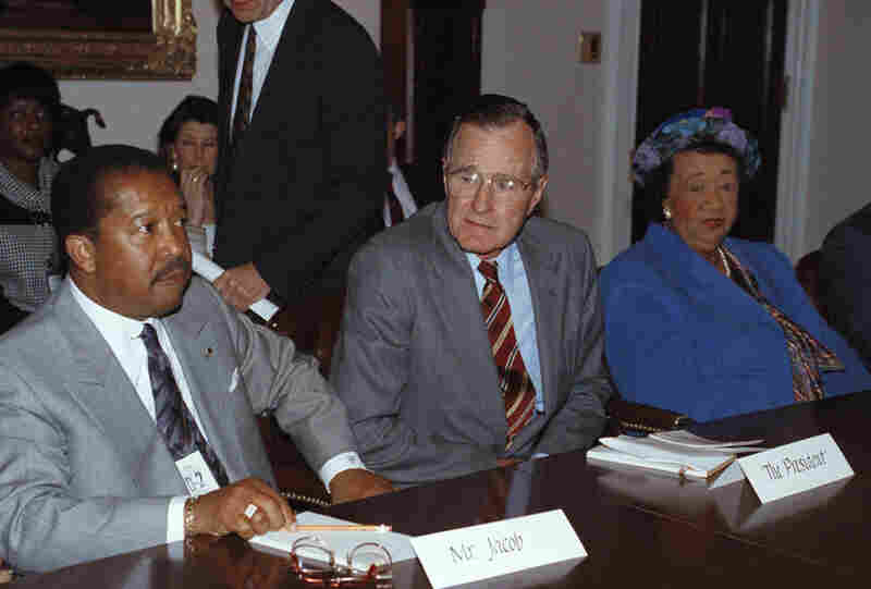 President George H. Bush meets with Height and John Jacob of the Urban League, meet in the Cabinet Room of the White House in Washington on May 1, 1992. The president met with civil rights leaders to discuss the rioting in Los Angeles.