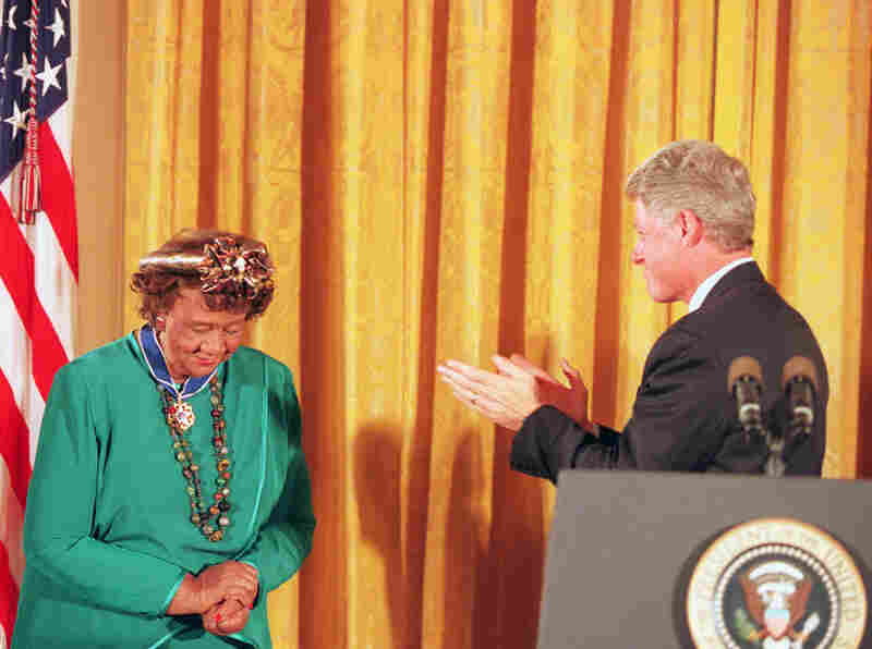 President Clinton applauds Height after presenting her with the Presidential Medal of Freedom during a ceremony in the White House East Room on Aug. 8, 1994.