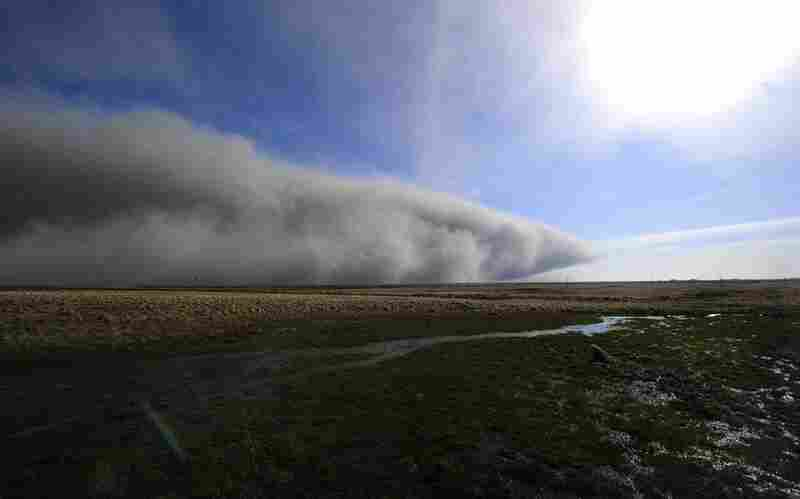 Smoke and ash from the Eyjafjallajokull volcano blow across a field April 19 near Nupur, Iceland.