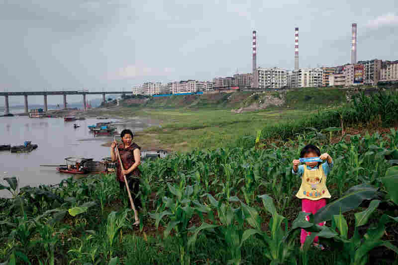A power plant spewing carbon dioxide competes for Yangtze water with family farms in Chongqing — a burgeoning municipality whose 31 million people depend on the river for daily needs.