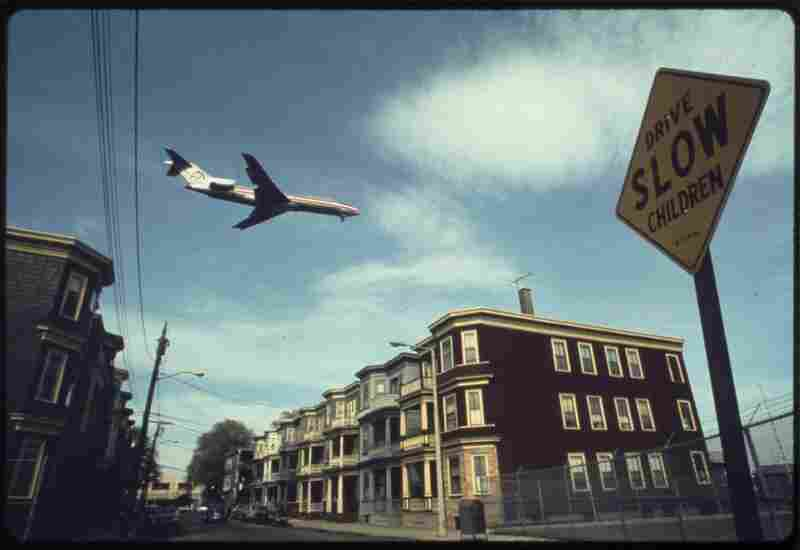 A plane flies over a neighborhood as it approaches Logan Airport in Massachusetts, May 1973.