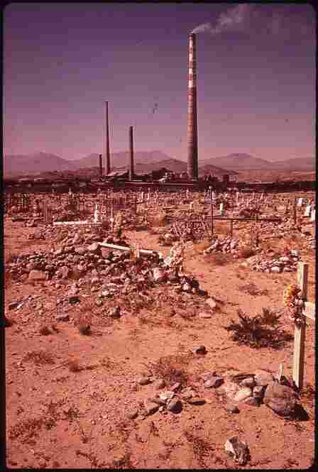 Smelter cemetery, where employees of the Asarco Smelter Works in El Paso, Texas (in background) can be buried, April 1972.