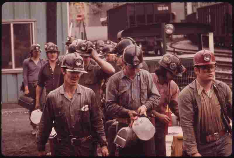 Miners line up to go into the elevator shaft at the Virginia-Pocahontas Coal Co. Mine No. 4 near Richlands, Va. The man at the right wears a red hat to signify that he is a new miner. April 1974.