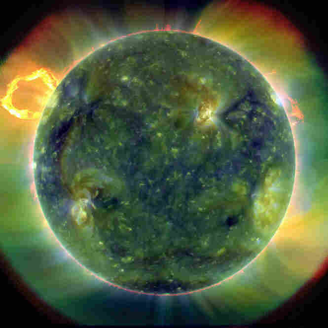 This ultraviolet image of the sun, with false color traces, indicates different gas temperatures. The blues and greens show the hottest, at nearly 1.8 million degrees Fahrenheit, while reds are around 107,000 degrees. The new telescope, currently orbiting the Earth, was designed to study the sun's magnetic field and its influence on Earth.