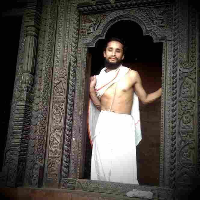 Hindu priest at a Tibetan Temple, Varanasi.