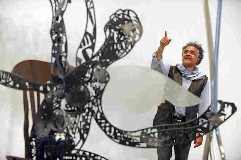 Nadim Karam with his piece The Fisherman and the Cloud, 2010. Courtesy of Jacki Lyden)