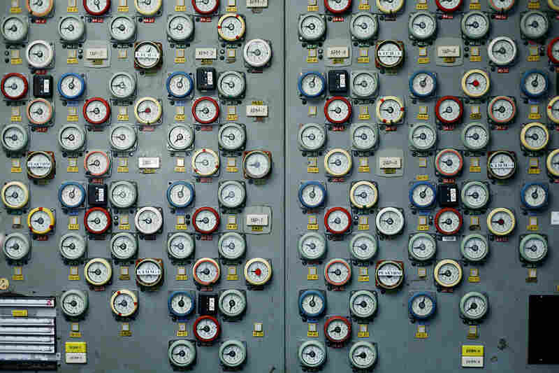 """""""A wall of dials in the a Chernobyl control room once monitored the reactors ... Most estimates say ninety-five percent of the radioactive materials remained on the grounds of the power plant or spread to the adjacent forest. Both were decontaminated, using the labor of about 850,000 liquidators from across the Soviet Union."""""""
