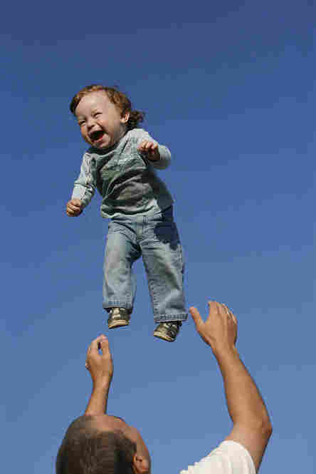 """""""Andrei Balta throws his fifteen-month-old son Vanya in the air during a summer evening in Slavutych, Ukraine. Every evening, parents with babies and toddlers gather in the central square of Slavutych to socialize. Andrei and his wife Anna both work at the nearby Chernobyl Nuclear Power Plant, as do over 3,800 residents of Slavutych."""""""