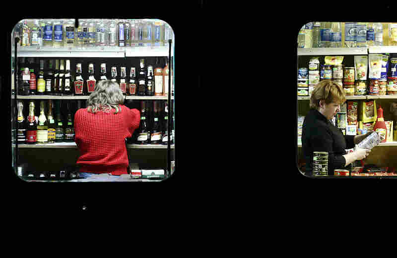 """""""In Sukachi, Ukraine, a small food and liquor store in a converted trailer doubles as the village bar. The store's two employees work up to twelve hours a day and earn about $200 per month. Sukachi, a village of about 2,000, is south of the Chernobyl Exclusion Zone."""""""