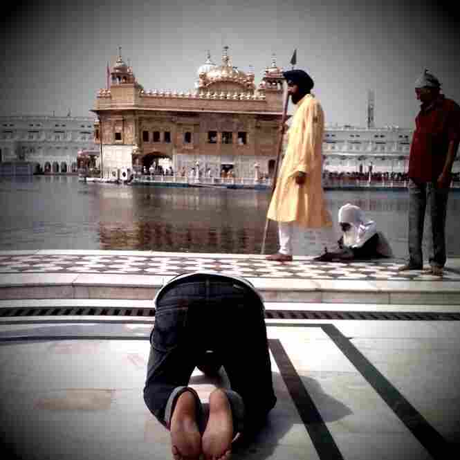 Kneeling at Golden Temple, Amritsar.