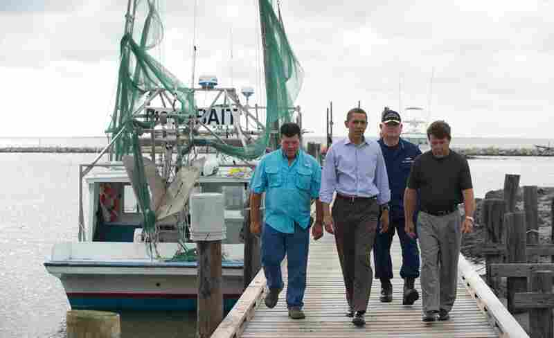 President Obama walks alongside Grand Isle Mayor David Camardelle (from right), U.S. Coast Guard Adm. Thad Allen, who is in charge of the federal response to the spill, and Chris Camardelle after meeting with local business owners in Grand Isle, La., June 4.
