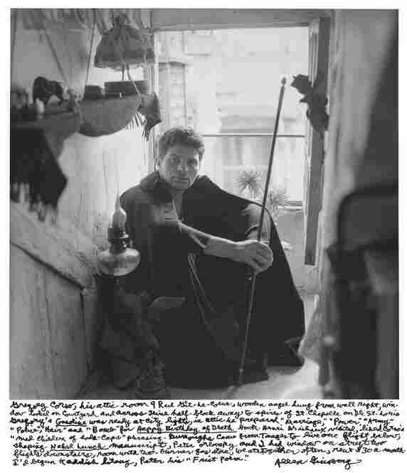 """Gregory Corso, his attic room 9 Rue Git-le-Coeur, wooden angel hung from wall right, window looked on courtyard and across Seine half-block away to spires of St. Chapelle on Ile St. Louis."" 1956"