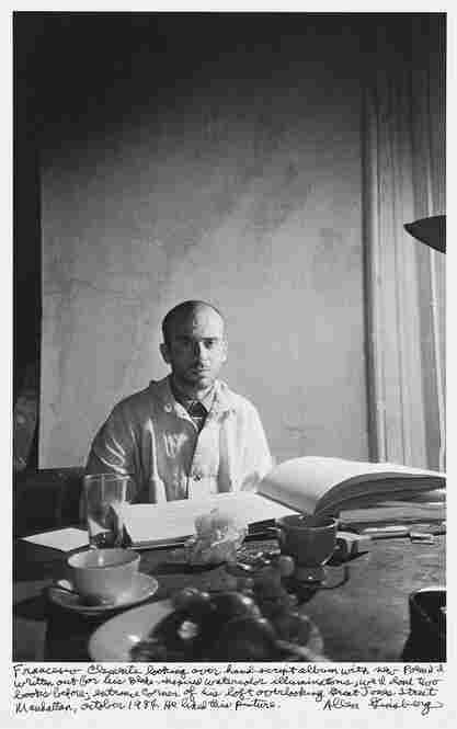 """Franceso Clemente looking over hand-script album with new poem I'd written out for his Blake-inspired watercolor illuminations, we'd done two books before; entrance corner of his loft overlooking Great Jones Street Manhattan, October 1984. He liked this picture."""