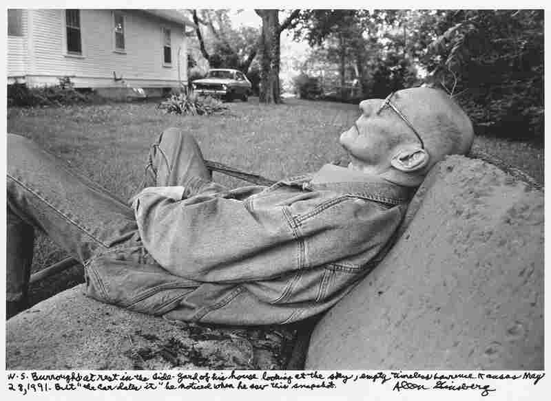 """W. S. Burroughs at rest in the side-yard of his house looking at the sky, empty timeless Lawrence Kansas May 28, 1991. But ""the car dates it"" he noted when he saw this snapshot."" 1991"