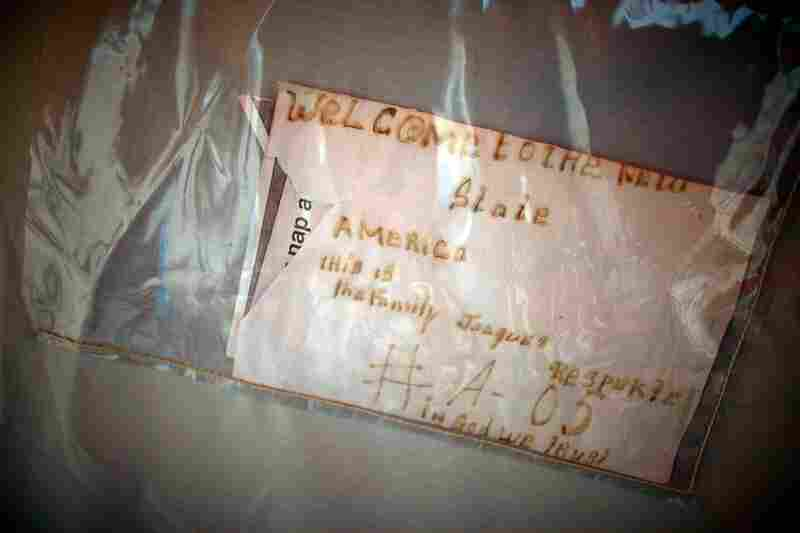 A welcome sign sign hangs outside a tent. The people who have moved to Camp Corail are struggling with the distance to the main city — and with the fact that there are no jobs in the area.