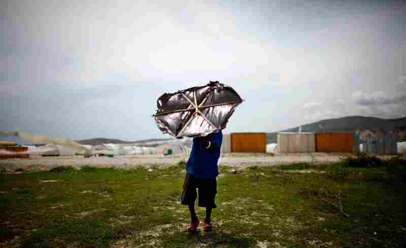 A Haitian boy attempts to fly a kite. Compared with the hustle of Port-au-Prince, Camp Corail is relatively quiet.