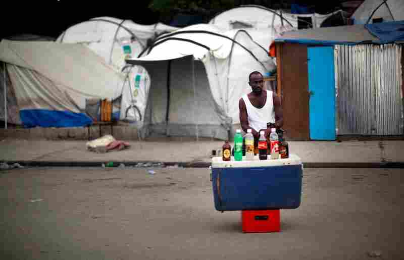 A vendor sells cold drinks outside a refugee camp near the collapsed presidential palace in downtown Port-au-Prince.