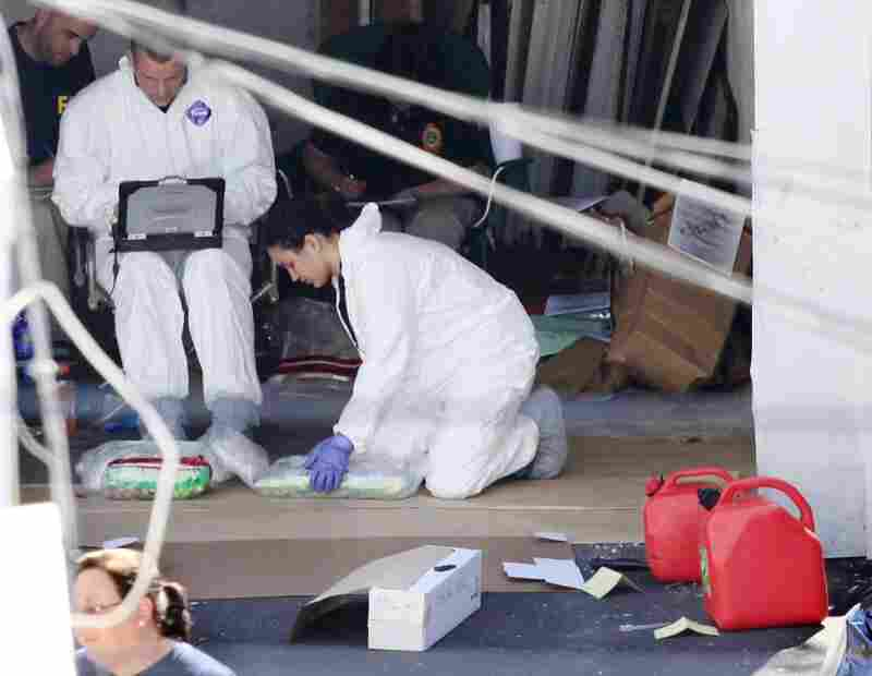 FBI agents inspect evidence in the garage of a house in Bridgeport, Conn., on Tuesday.