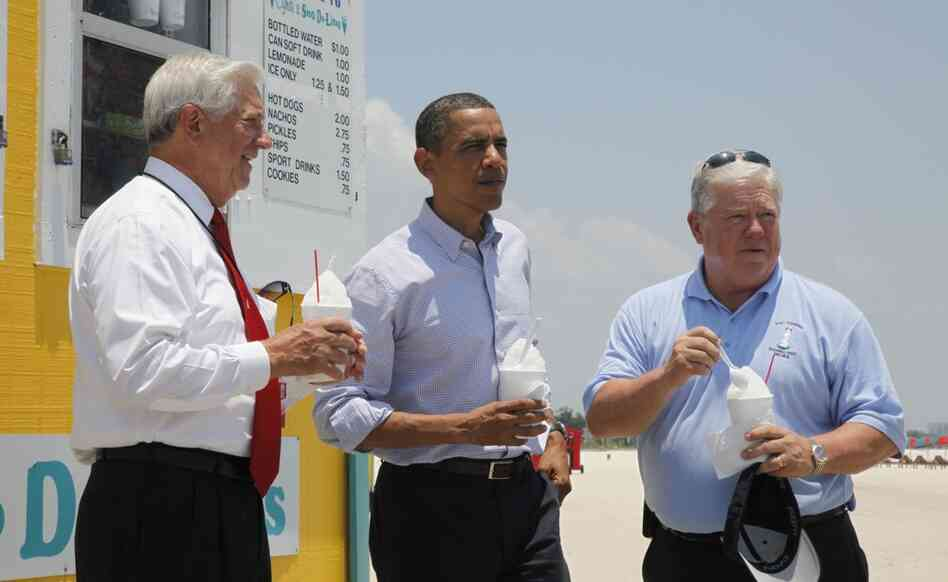 President Obama stands with Mississippi Gov. Haley Barbour (right) and Gulfport, Miss., Mayor George Schloegel after meeting with residents affected by the oil spill.