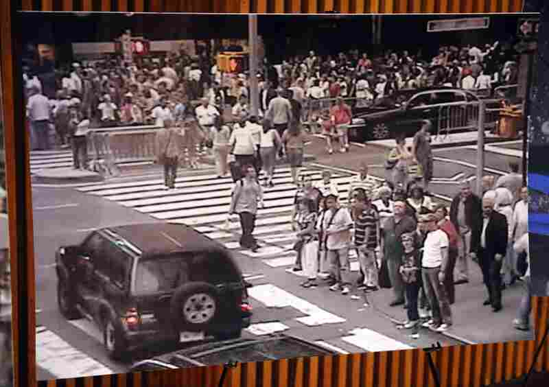 A still photo from a surveillance camera shows the bomb-laden Nissan Pathfinder driving through crowds of people Saturday in Times Square.