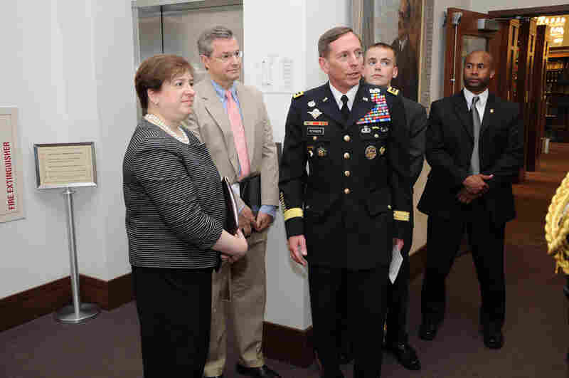 "Kagan and Gen. David Petraeus (center) participate in a pinning ceremony June 3, 2009, for Harvard Law School student Kyle Scherer. Opposition to Kagan is expected to focus partly on her stance on the military; at Harvard, she opposed letting military recruiters on campus because of the ""don't ask, don't tell"" policy."