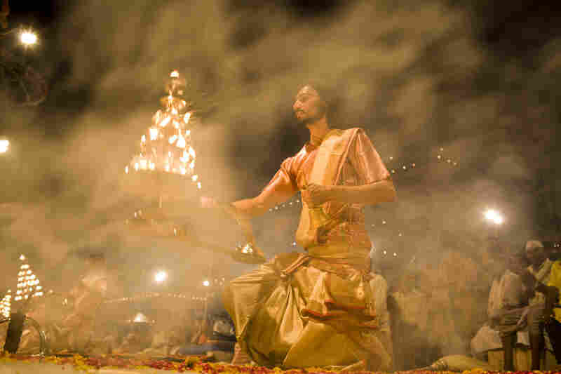Smoke envelops Vastoda as he waves a candle-studded lamp before Hindu worshippers during the aarti, the final step in which the light is used to express spiritual humility and gratitude.