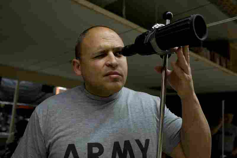 Guerrero, originally from Lima, Peru, now resides at Brooke Army Medical Center in San Antonio, Texas. Here, he looks through a scope at the shooting range at the TMI private school in San Antonio.