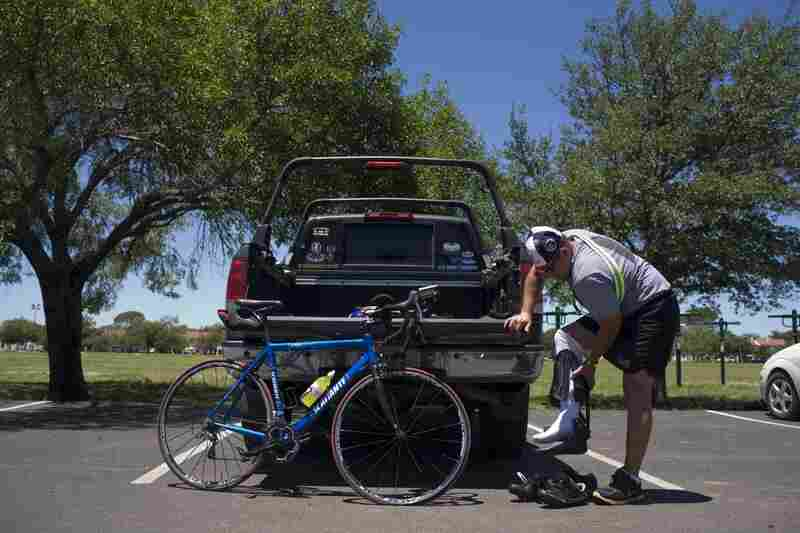 Guerrero suffered injuries to both his legs while serving with the Army in Iraq in 2007. He also suffers from PTSD, and doesn't like to ride in the passenger side of cars which can trigger memories of the accident. Here, he prepares to cycle on base in San Antonio.