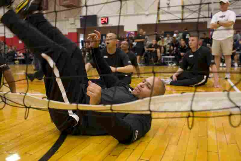 """Guerrero competes in a sitting volleyball match. In this sport, the net is about 3 feet high. Players are allowed to block serves, but one """"cheek"""" must be in contact with the floor whenever they touch the ball."""