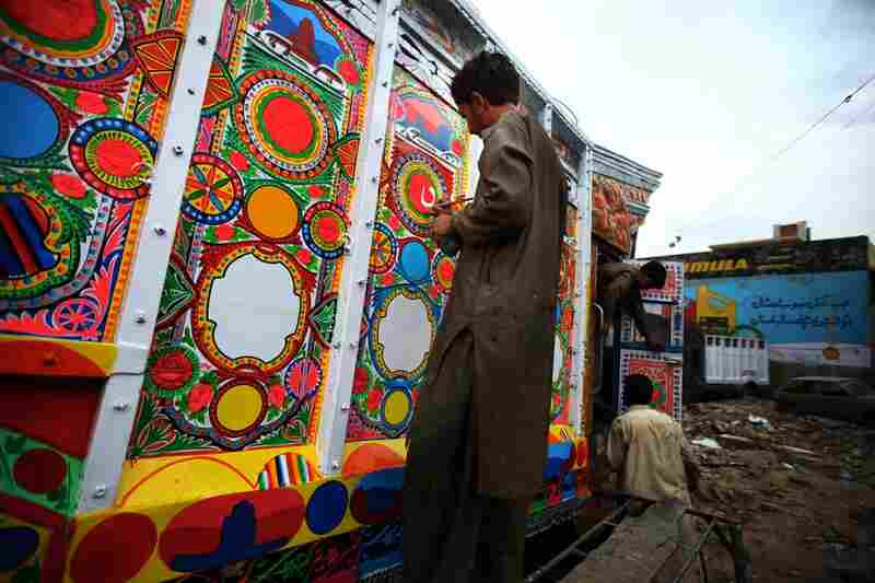 Artist Mohammad Saeed, 32, works on the details of a truck. Nearly all trucks driving on the Grand Trunk Road are fully painted inside and out, with tin and wood details and a huge decorated hood above the driver's cab.